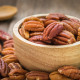 Pecan nuts in wooden bowl