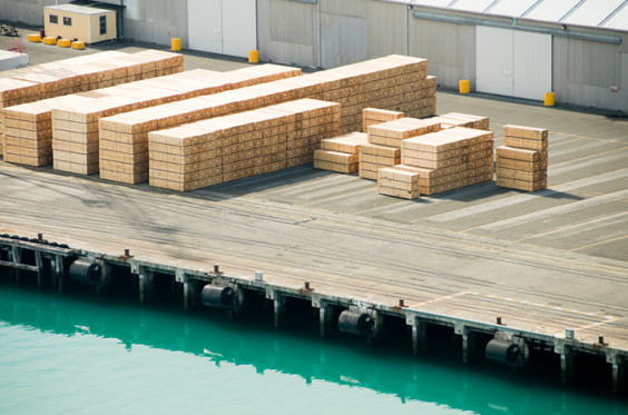 Tonnes of processed timber stacked on a New Zealand dock.
